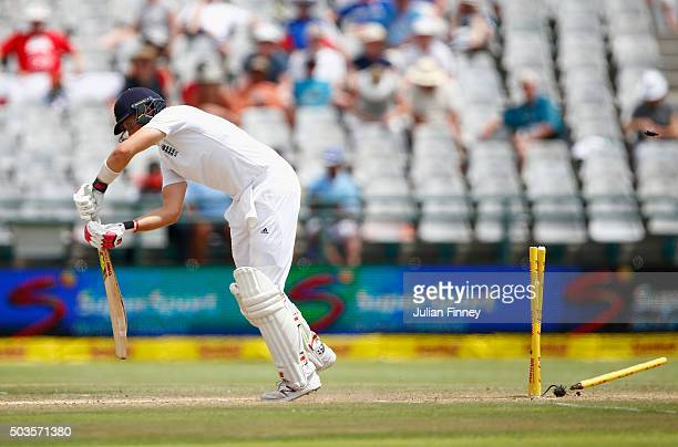 Joe Root of England is bowled out by Chris Morris of South Africa during day five of the 2nd Test at Newlands Stadium on January 6 2016 in Cape Town...