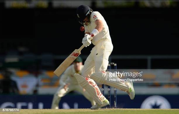 Joe Root of England is hit on the helmet by a bouncer bowled by Mitchell Starc of Australia on the third day of the first Ashes cricket test match...