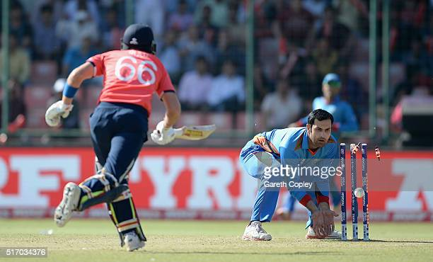Joe Root of England is run out by Mohammad Nabi of Afghanistan during the ICC World Twenty20 India 2016 Group 1 match between England and Afghanistan...
