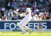 Joe Root of England is struck on the shoulder during day one of the 2nd Investec Test match between England and Pakistan at Old Trafford on July 22...