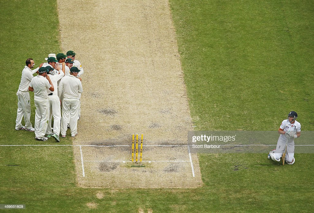 <a gi-track='captionPersonalityLinkClicked' href=/galleries/search?phrase=Joe+Root&family=editorial&specificpeople=6688996 ng-click='$event.stopPropagation()'>Joe Root</a> (R) of England looks dejected after being run out by Mitchell Johnson of Australia during day three of the Fourth Ashes Test Match between Australia and England at Melbourne Cricket Ground on December 28, 2013 in Melbourne, Australia.