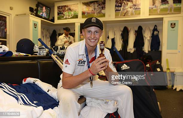 Joe Root of England poses with the urn in the dressing room after winning the Ashes during day five of the 5th Investec Ashes Test match between...