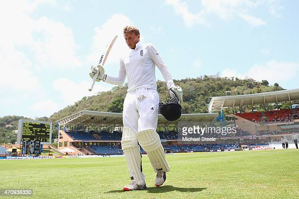 Joe Root of England raises his bat after being undefeated on 182 runs during day four of the 2nd Test match between West Indies and England at the...