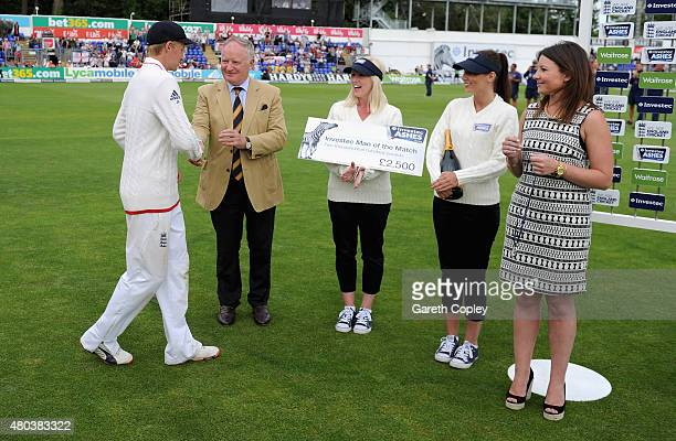 Joe Root of England receives his man of match award after winning the 1st Investec Ashes Test match between England and Australia at SWALEC Stadium...