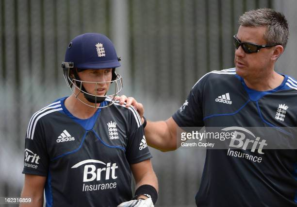 Joe Root of England speaks with coach Ashley Giles during an England nets session at Eden Park on February 22 2013 in Auckland New Zealand