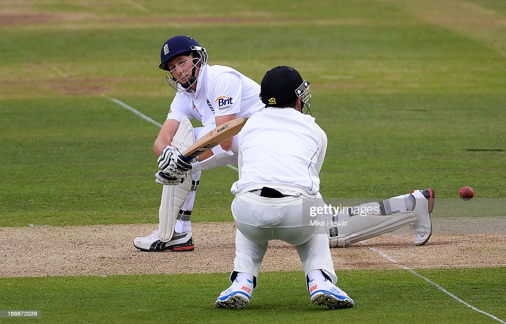<a gi-track='captionPersonalityLinkClicked' href=/galleries/search?phrase=Joe+Root&family=editorial&specificpeople=6688996 ng-click='$event.stopPropagation()'>Joe Root</a> of England sweeps during day one of 1st Investec Test match between England and New Zealand at Lord's Cricket Ground on May 16, 2013 in London, England.