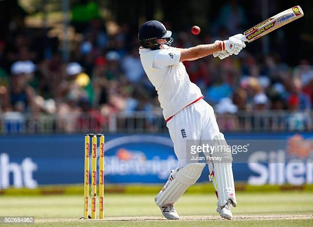 Joe Root of England swings and misses during day three of the 1st Test between South Africa and England at Sahara Stadium Kingsmead on December 28...