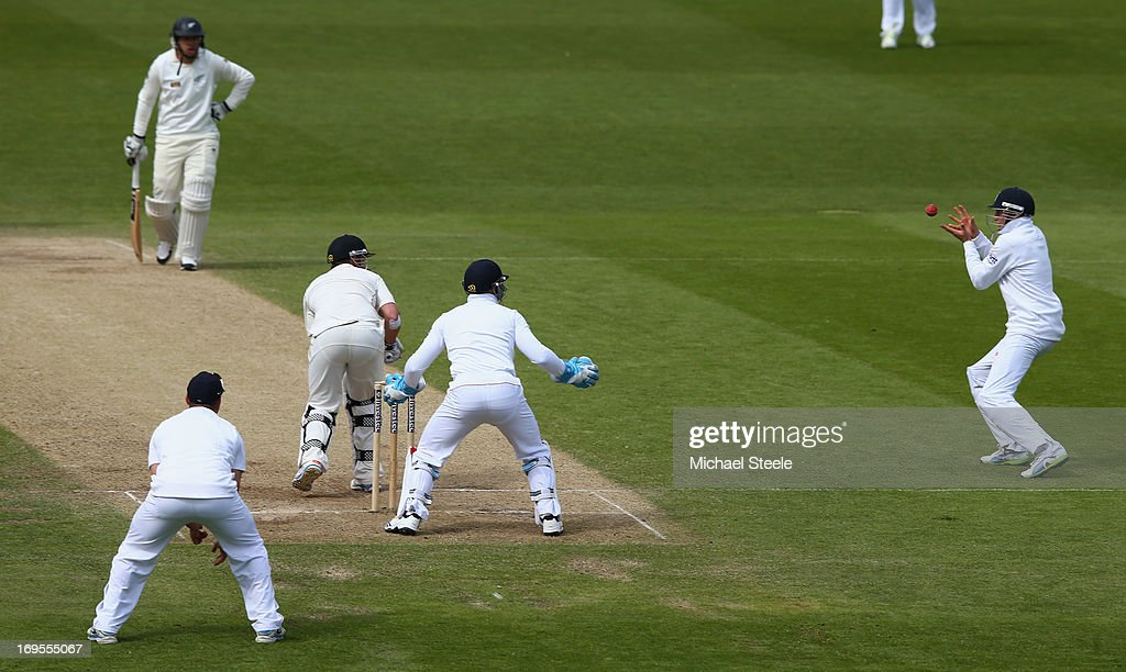 Joe Root of England takes a catch off the bowling of Graeme Swann to dismiss Hamish Rutherford of New Zealand during day four of the 2nd Investec...