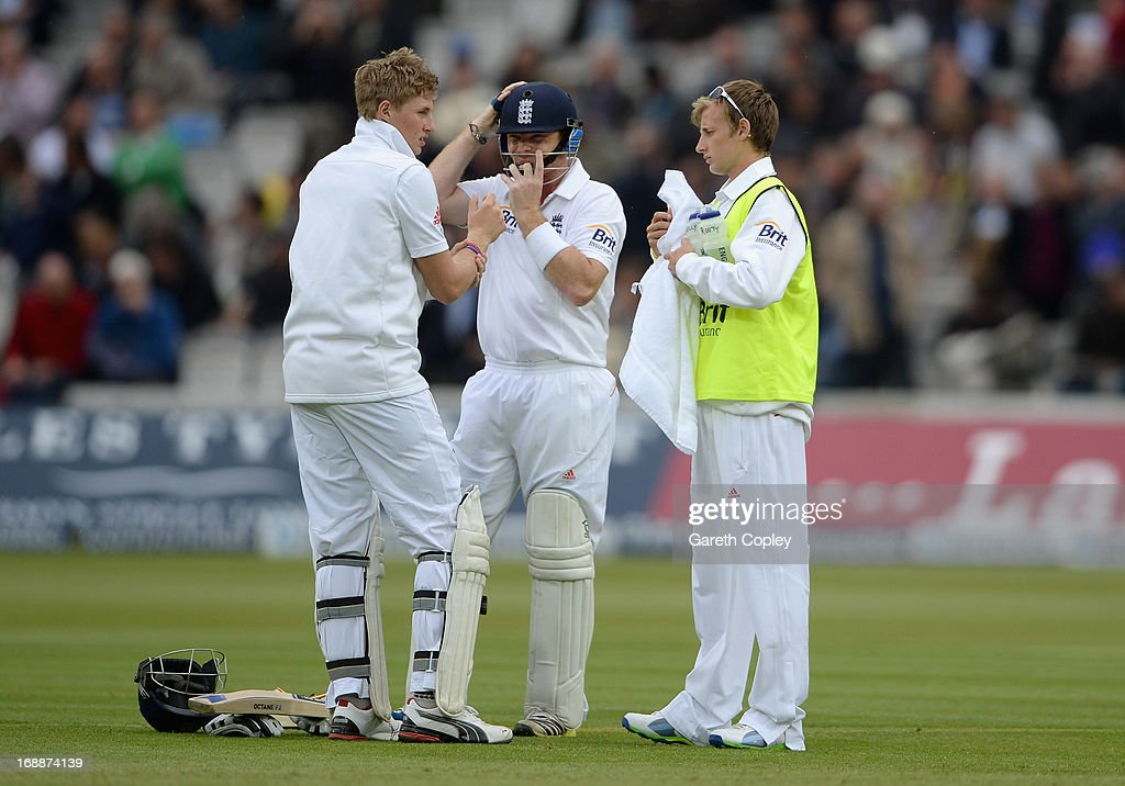Joe Root of England with his brother and 12th man Bill Root during day one of 1st Investec Test match between England and New Zealand at Lord's Cricket Ground on May 16, 2013 in London, England.