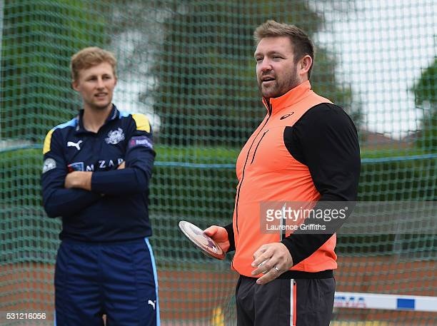 Joe Root of Yorkshire is given advice by discus thrower Dan Greaves of Great Britain during the NatWest T20 Blast Media Launch at Loughborough...