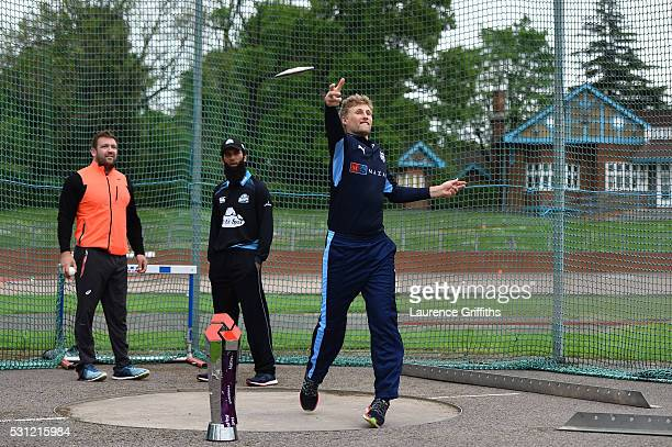 Joe Root of Yorkshire throws a discus watched by discus thrower Dan Greaves of Great Britain and Moeen Ali of Worcestershire during the NatWest T20...