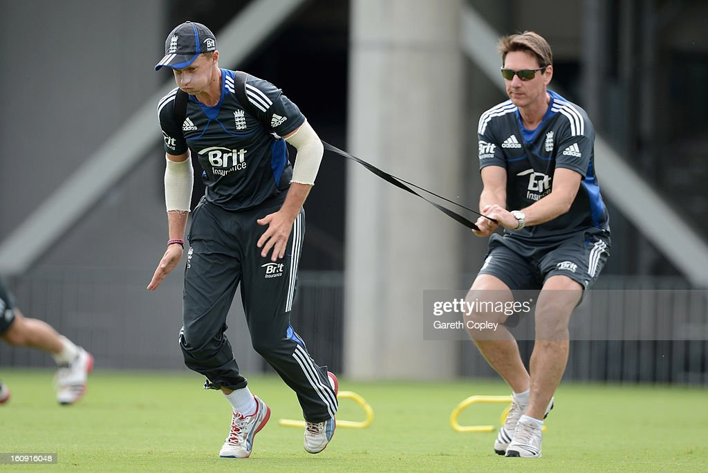 Joe Root warms up with team doctor Nick Pierce during an England nets session at Eden Park on February 8, 2013 in Auckland, New Zealand.