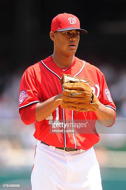 Joe Ross of the Washington Nationals pitches in his major league debut during a baseball game against the Chicago Cubs at Nationals Park on June 6...