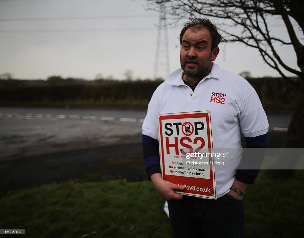 Joe Rukin from the Stop the HS2 Campaign talks to the media near to the planned location of the new HS2 high speed rail link as it passes by the village of Hoo Green on January 28, 2013 in Knutsford, United Kingdom. The government has today released details of the next phase of the GBP 32 billion HS2 high-speed rail network, which will link Manchester and Leeds.