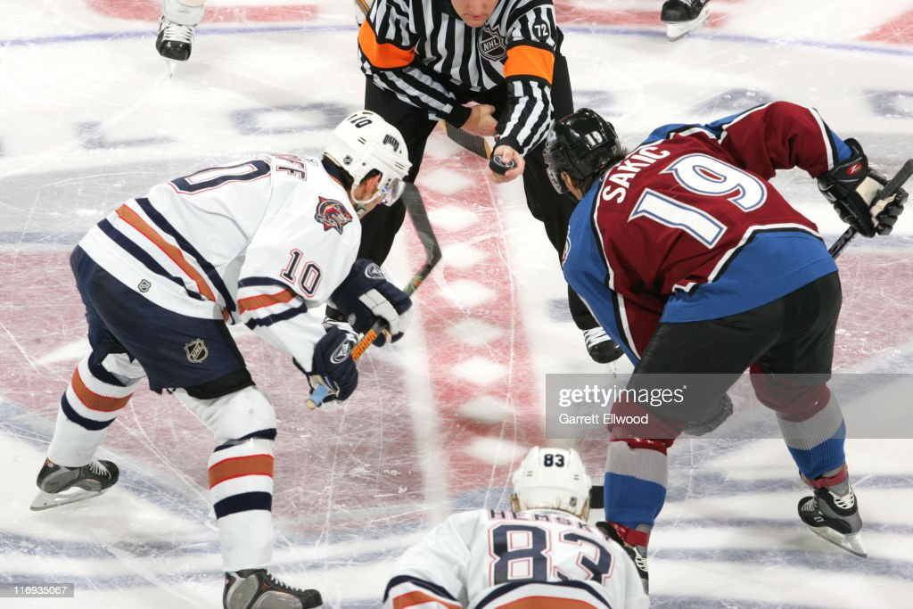 Joe Sakic of the Colorado Avalanche faces off against Shawn Horcoff of the Edmonton Oilers on February 7 2006 at Pepsi Center in Denver Colorado