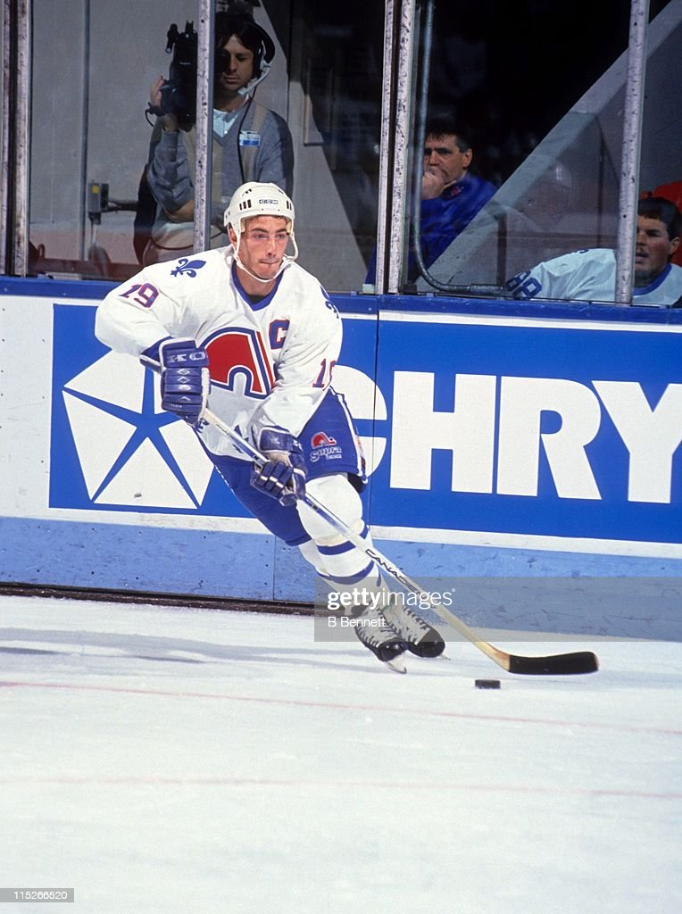 <a gi-track='captionPersonalityLinkClicked' href=/galleries/search?phrase=Joe+Sakic&family=editorial&specificpeople=202869 ng-click='$event.stopPropagation()'>Joe Sakic</a> #19 of the Quebec Nordiques skates with the puck during an NHL game circa 1991 at the Quebec Coliseum in Quebec City, Quebec, Canada.