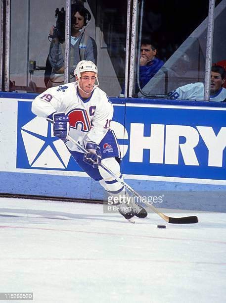 Joe Sakic of the Quebec Nordiques skates with the puck during an NHL game circa 1991 at the Quebec Coliseum in Quebec City Quebec Canada