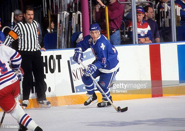 Joe Sakic of the Quebec Nordiques skates with the puck during an NHL game against the New York Rangers on October 27 1992 at the Madison Square...