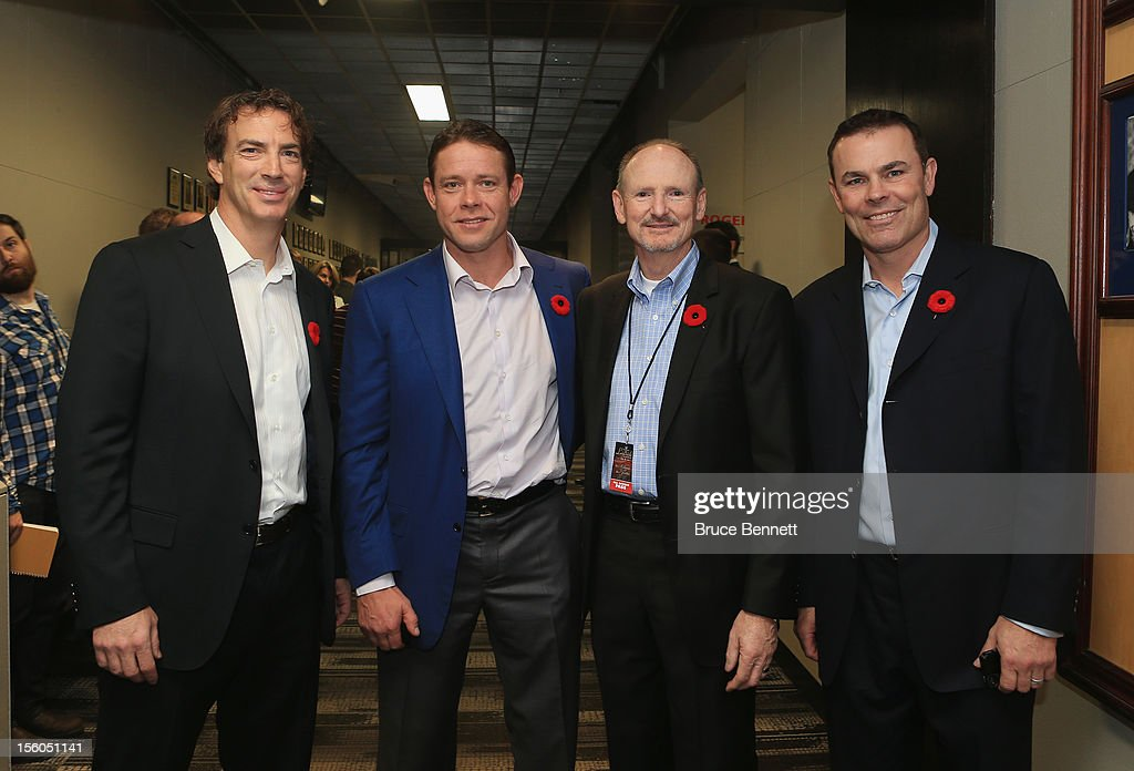 Joe Sakic, Pavel Bure, Barrie Stafford and Adam Oates, pose for a photo prior to the Hockey Hall of Fame Legends Game at the Air Canada Centre on November 11, 2012 in Toronto, Canada. Stafford, the long time trainer for the Edmonton Oilers will be honored along with the players at the Hockey Hall of Fame induction ceremony at the Hall on November 12.