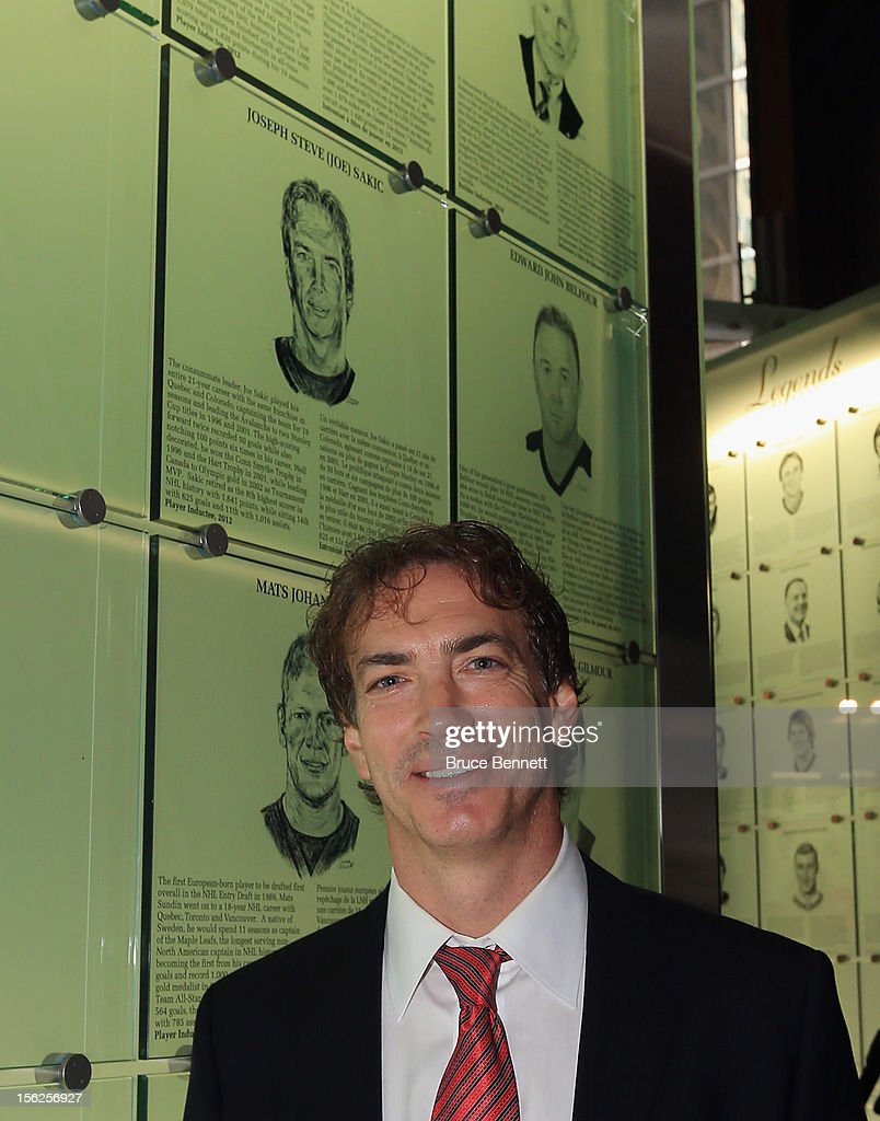 Joe Sakic poses by his Hall of Fame plaque following a photo opportunity at the Hockey Hall of Fame on November 12, 2012 in Toronto, Canada. Sakic and three other former NHL players - Mats Sundin, Adam Oates and Pavel Bure - will be inducted into the Hall during a ceremony later today.