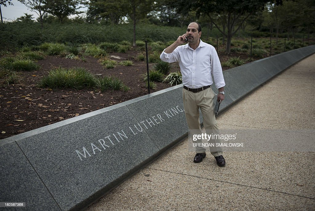 Joe Salvatore, National Park Service Director of Facilities and Services, speaks on the phone whole closing the Martin Luther King, Jr. Memorial on the National Mall October 1, 2013 in Washington, DC. The US government is in a forced shutdown after lawmakers failed to pass a spending bill last night. AFP PHOTO/Brendan SMIALOWSKI