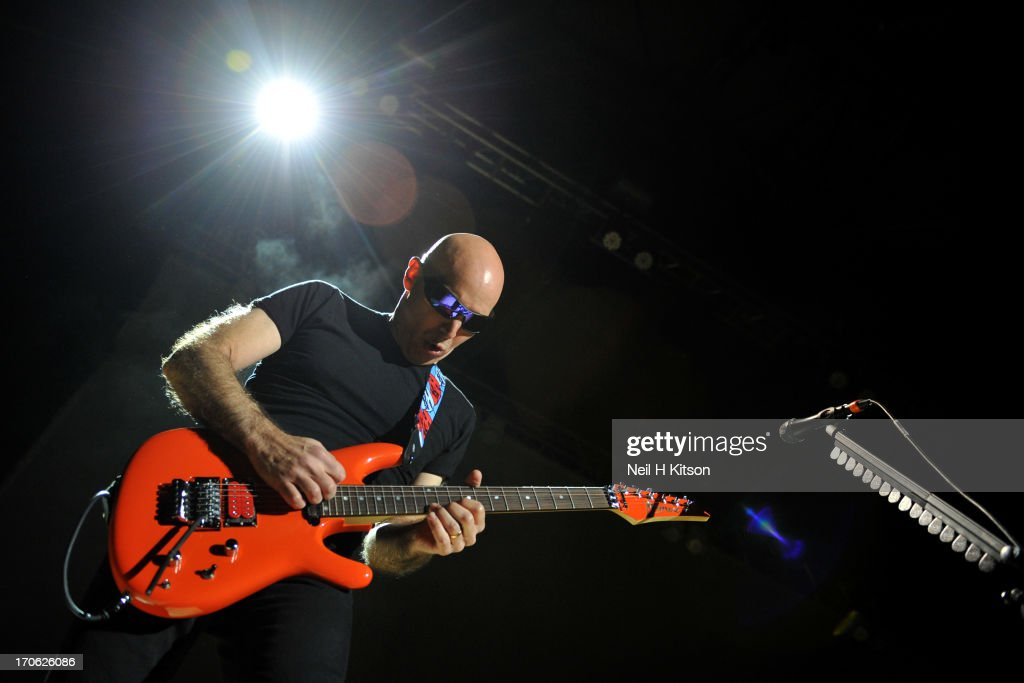 <a gi-track='captionPersonalityLinkClicked' href=/galleries/search?phrase=Joe+Satriani&family=editorial&specificpeople=790021 ng-click='$event.stopPropagation()'>Joe Satriani</a> performs on stage at Sheffield City Hall on June 15, 2013 in Sheffield, England.