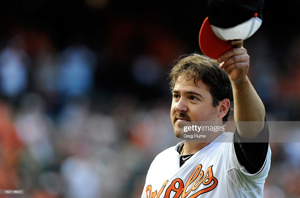 <a gi-track='captionPersonalityLinkClicked' href=/galleries/search?phrase=Joe+Saunders&family=editorial&specificpeople=835979 ng-click='$event.stopPropagation()'>Joe Saunders</a> #48 of the Baltimore Orioles tips his hat to the crowd after leaving the game in the eighth inning against the Boston Red Sox at Oriole Park at Camden Yards on September 30, 2012 in Baltimore, Maryland. Baltimore won the game 6-3.