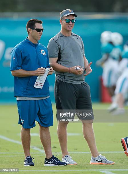 Joe Schoen Director of Player Personnel and Peyton Manning former NFL quarterback watches the Miami Dolphins run drills during the teams training...