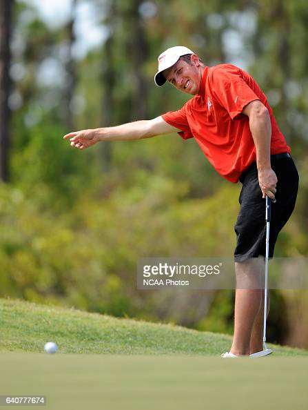 Joe Schoolmeesters of St John's University putts on the 12th hole green during the Division III Men's Golf Championship held at the PGA Golf Club in...