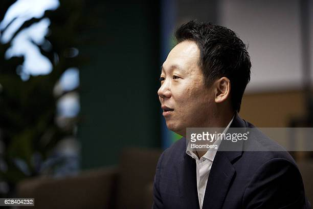 Joe Seunghyun Cho founder of Marvelstone Group speaks with a colleague at the company's office in Singapore on Wednesday Nov 30 2016 Tax benefits...
