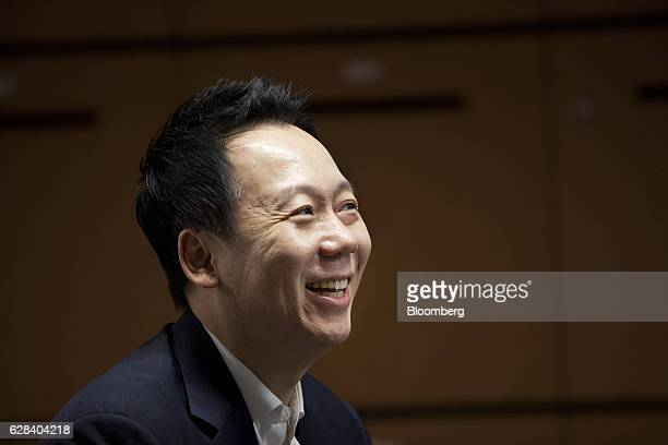 Joe Seunghyun Cho founder of Marvelstone Group speaks with a colleague unseen at the company's office in Singapore on Wednesday Nov 30 2016 Tax...