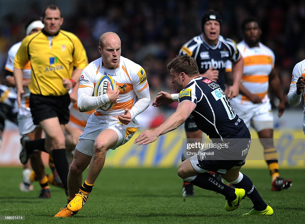 Joe Simpson of London Wasps in action with Mark Cueto of Sale Sharks during the Aviva Premiership match between Sale Sharks and London Wasps at the Salford City Stadium on May 04, 2013 in Salford, England.