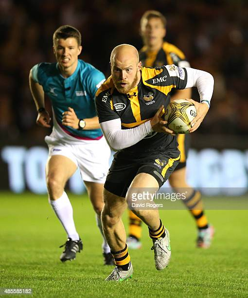 Joe Simpson of Wasps breaks clear to score a try against Scarlets during the Singha Premiership Rugby 7's Series finals at Twickenham Stoop on August...