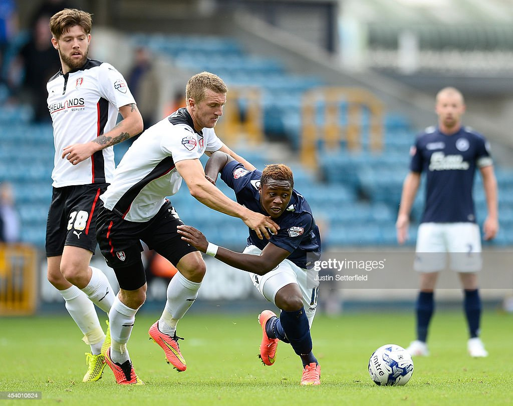 Joe Skarz of Rotherham United and <a gi-track='captionPersonalityLinkClicked' href=/galleries/search?phrase=Magaye+Gueye&family=editorial&specificpeople=7018117 ng-click='$event.stopPropagation()'>Magaye Gueye</a> of Millwall FC in action during the Sky Bet Championship match between Millwall and Rotherham United at The Den on August 23, 2014 in London, England.