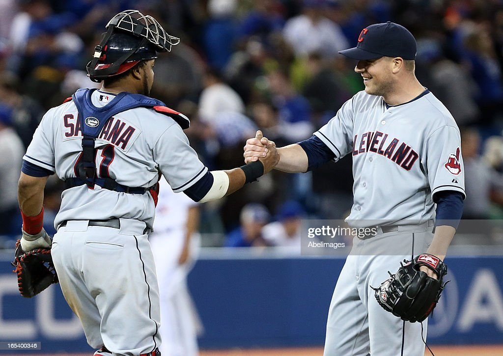 Joe Smith #38 and Carlos Santana #41 of the Cleveland Indians celebrate an 11th inning win against the Toronto Blue Jays during MLB action at the Rogers Centre April 3, 2013 in Toronto, Ontario, Canada.