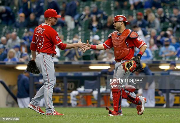Joe Smith and Geovany Soto of the Los Angeles Angels of Anaheim celebrate after beating the Milwaukee Brewers 73 at Miller Park on May 4 2016 in...