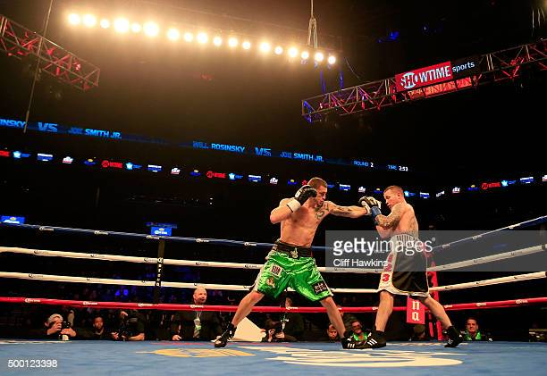 Joe Smith Jr punches Will Rosinsky during their Light Heavyweight bout on December 5 2015 in the Brooklyn borough of New York City