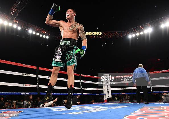 Joe Smith Jr reacts after punching Bernard Hopkins out of the ring for a ninth round TKO to win the WBC International Light Heavyweight title at The...