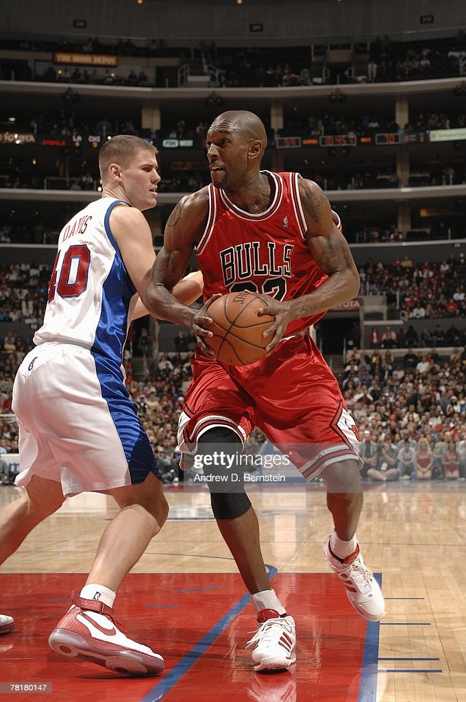 Joe Smith of the Chicago Bulls moves the ball against Paul Davis of the Los Angeles Clippers during the game at Staples Center on November 17 2007 in...