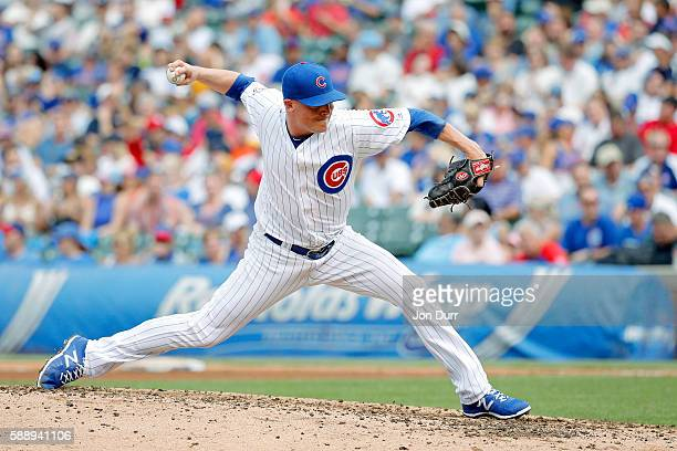 Joe Smith of the Chicago Cubs pitches against the St Louis Cardinals during the eighth inning at Wrigley Field on August 12 2016 in Chicago Illinois...