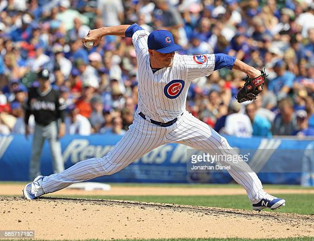 Joe Smith of the Chicago Cubs pitches in the 8th inning against the Miami Marlins at Wrigley Field on August 3 2016 in Chicago Illinois The Cubs...