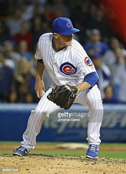 Joe Smith of the Chicago Cubs pitches to the last batter in the 9th inning against the Cincinnati Reds at Wrigley Field on September 21 2016 in...