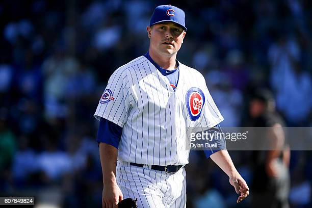 Joe Smith of the Chicago Cubs walks off the field in the seventh inning against the Milwaukee Brewers at Wrigley Field on September 18 2016 in...