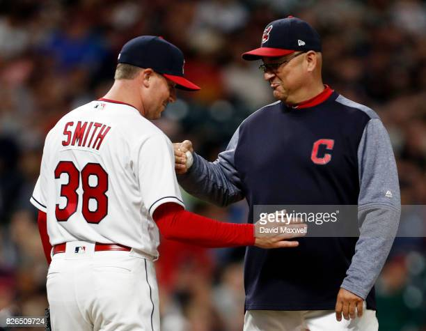 Joe Smith of the Cleveland Indians is congratulated by Manager Terry Francona as he is taken out of the game against the New York Yankees in the...