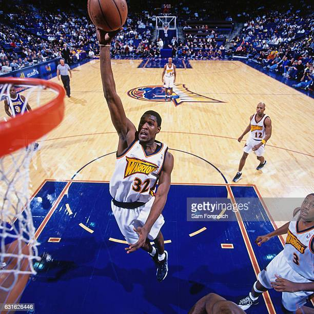Joe Smith of the Golden State Warriors dunks against the Los Angeles Lakers on December 10 1997 at Oracle Arena in Oakland California NOTE TO USER...
