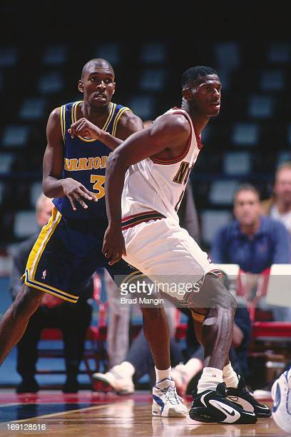 Joe Smith of the Golden State Warriors posts up against Antonio McDyess of the Denver Nuggets circa 1996 at the OaklandAlameda County Coliseum Arena...
