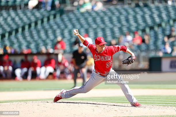 Joe Smith of the Los Angeles Angels of Anaheim pitches during the game against the Oakland Athletics at Oco Coliseum on September 2 2015 in Oakland...