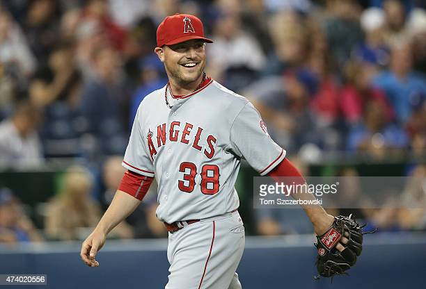 Joe Smith of the Los Angeles Angels of Anaheim reacts after getting the last out of the eighth inning during MLB game action against the Toronto Blue...