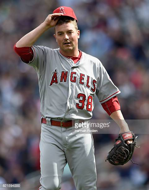 Joe Smith of the Los Angeles Angels of Anaheim reacts to giving up a solo home run to Oswaldo Arcia of the Minnesota Twins during the eighth inning...