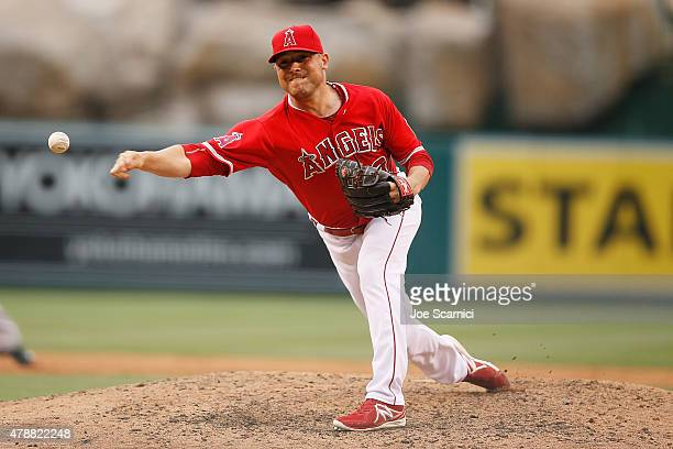 Joe Smith of the Los Angeles Angels of Anaheim throws a pitch in the eighth inning against the Seattle Mariners at Angel Stadium of Anaheim on June...